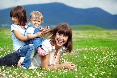 Happy young mother with daughter resting outdoors photo