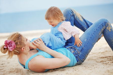 Happy family resting at beach in summer Stock Photo - 7013235