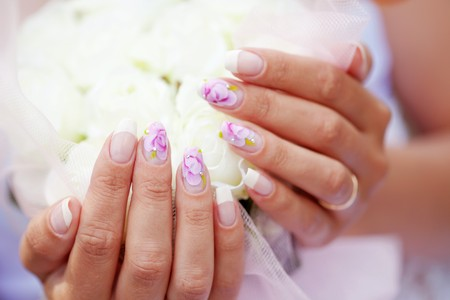 french woman: Close-up shot of art bridal manicure with painted nails Stock Photo
