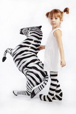 Studio portrait of funny little zebra photo
