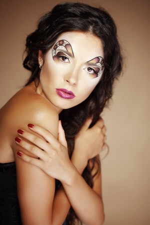 Fashion make-up with face art and hairstyle. photo