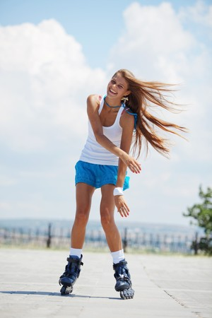 Beautiful teenage girl rollerskating in park Stock Photo - 7359346
