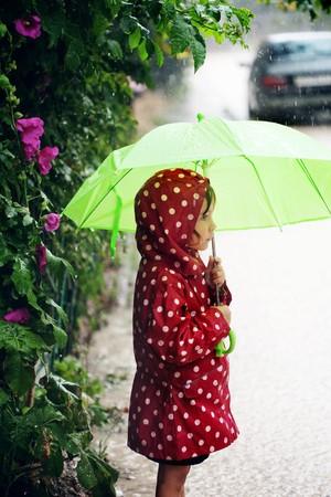 raincoat: Little child walking in the rain