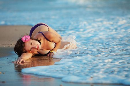 Young beutiful sexy girl resting on beach in the water Stock Photo - 7481032