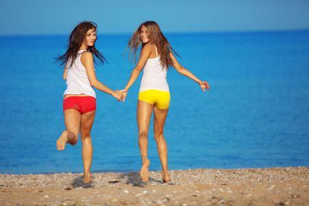 Beautiful girls having fun at beach photo