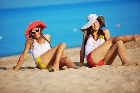 Two beautiful girls at beach photo