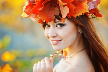 Vibrant fall portrait of beautiful female close-up photo