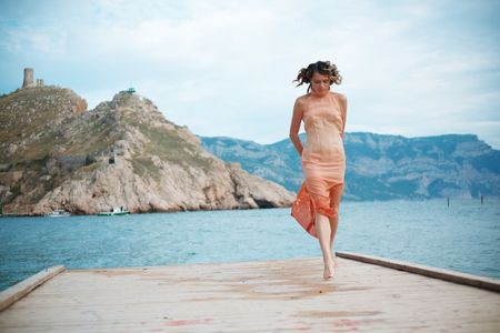 Beautiful fashion girl resting on berth at beach. photo