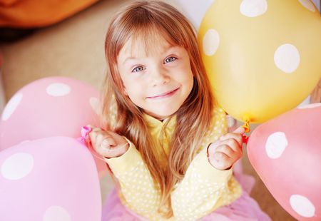 air baby: Happy child holding bunch of air balloons