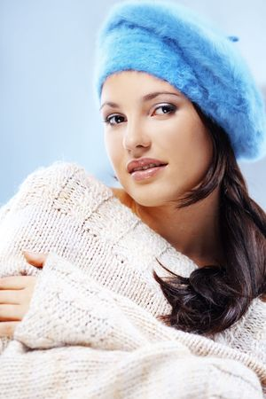 Portrait of beautiful young woman wearing fashion winter clothing photo