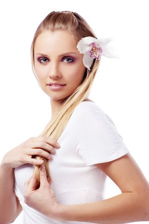 Portrait of very beautiful woman with orchid in her hair photo