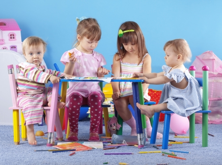 Group of kids playing in the kindergarten photo