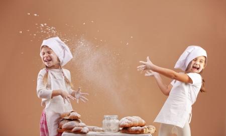 children cooking: Little cute bakers studio shot