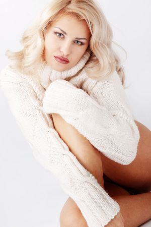 Portrait of pure beautiful woman wearing winter warm clothing over white photo