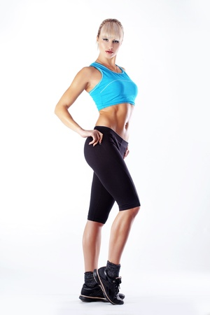 sports form: Young beautiful fitness woman over white Stock Photo