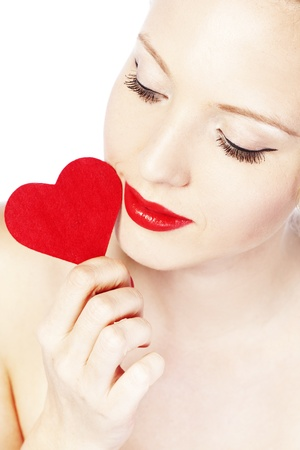 Beautiful gorgeous woman with glamour bright makeup and red heart photo