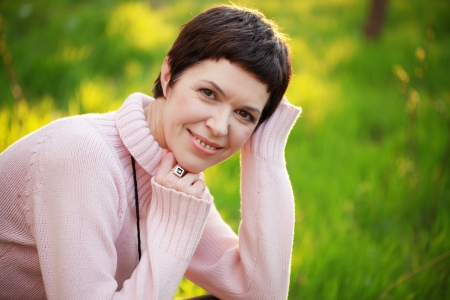 middle aged woman smiling: Portrait of beautiful middle aged woman in spring