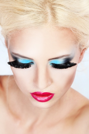 blonde blue eyes: Beautiful young woman with fashion make-up Stock Photo