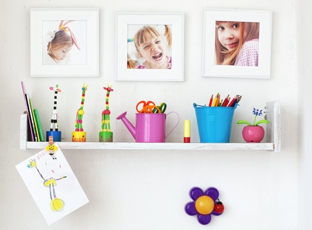 photo of accessories: Kids shelf on white wall with toys on it Stock Photo