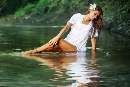 long lake: Beautiful young girl resting in water Stock Photo