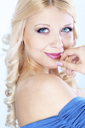 Portrait of young beautiful blond woman with fashion make-up and hairstyle Stock Photo - 9457218