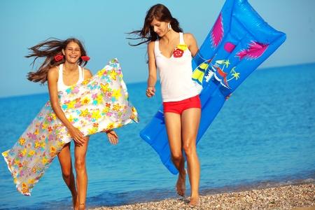 girl action: Beautiful girls having fun in water at beach