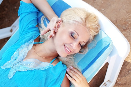 Beautiful blond girl relaxing on beach bad Stock Photo - 9589208