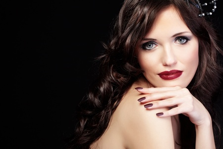Studio shot of beautiful woman with long hair and red lips photo