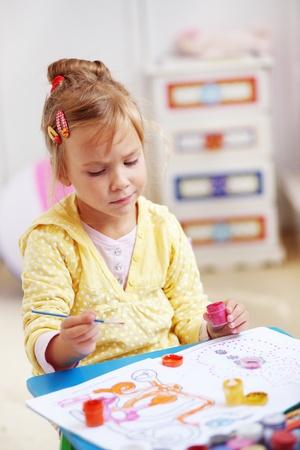 Child painting in the kindergarten photo