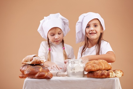 Little cute bakers studio shot Stock Photo - 9824837