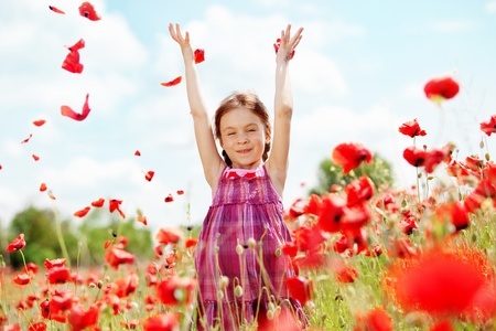 field of flowers: Cute child girl at poppy field