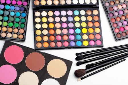 Make-up colorful eyeshadow palettes with makeup brushes photo
