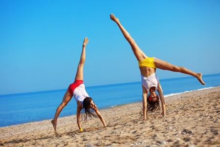 Beautiful girls having fun at beach Stock Photo - 9967057