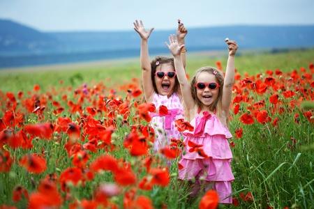 Cute children in poppy field Stock Photo