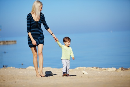 Young mother with her kid resting at the beach Stock Photo - 9967086