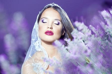 bridal makeup: Bride posing at lavender field at night