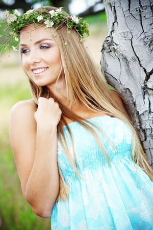 Young beautfiul woman walking outdoors at summer photo