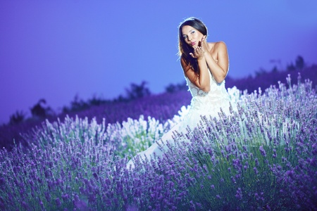 Bride posing at lavender field at night photo