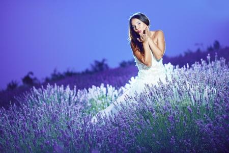 wedding night: Bride posing at lavender field at night