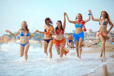 young girl bikini: Group of young beautiful girls having fun at beach Stock Photo