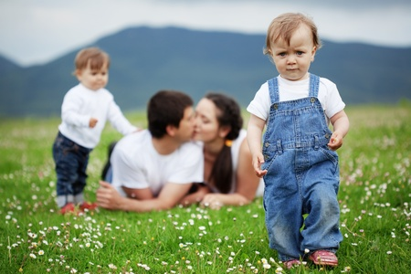 Happy young family with twins resting outdoors Stock Photo - 10569050