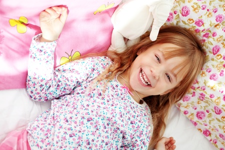 Portrait of child waking up at morning photo