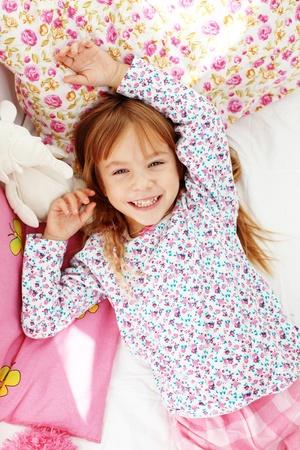 wake up happy: Portrait of child waking up at morning