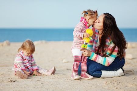 Happy family resting at beach Stock Photo
