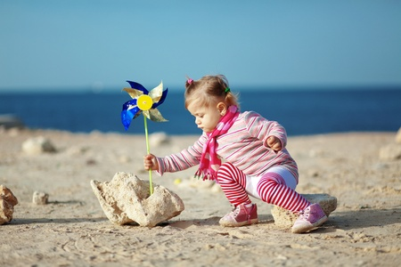 Child walking at the beach photo