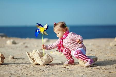 Child walking at the beach photo