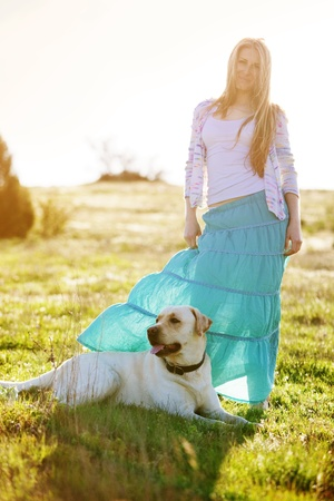 Young woman with ger dog resting at green field Stock Photo - 10594171