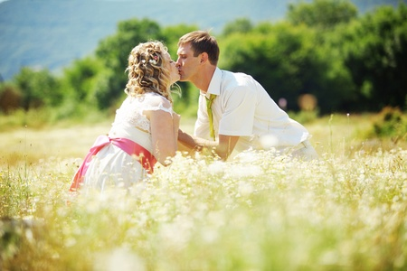 Wedding couple walking outdoor in field