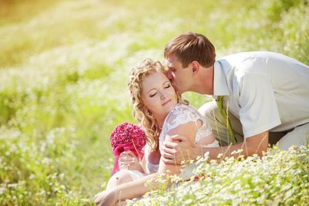 feelings of happiness: Wedding couple walking outdoor in field
