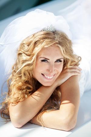 wedding hairstyle: Beautiful bride posing in her wedding day Stock Photo